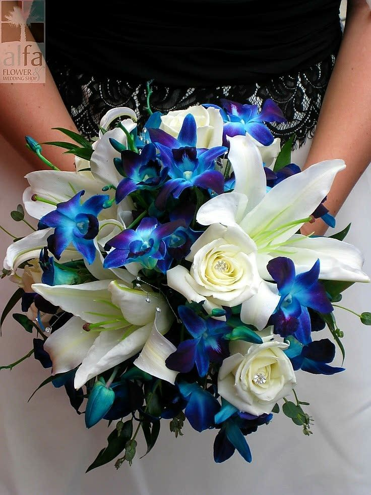 Stunning Wedding Bouquet Featuring: White Casablanca Lilies, White Roses + Blue Dendrobium Orchids