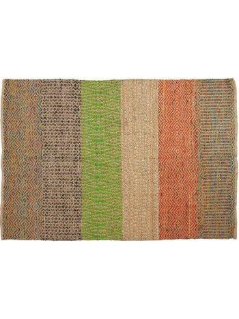 Un magnifico tappeto in juta intrecciata, per arredare con la purezza e la preziosità di una fibra naturale.