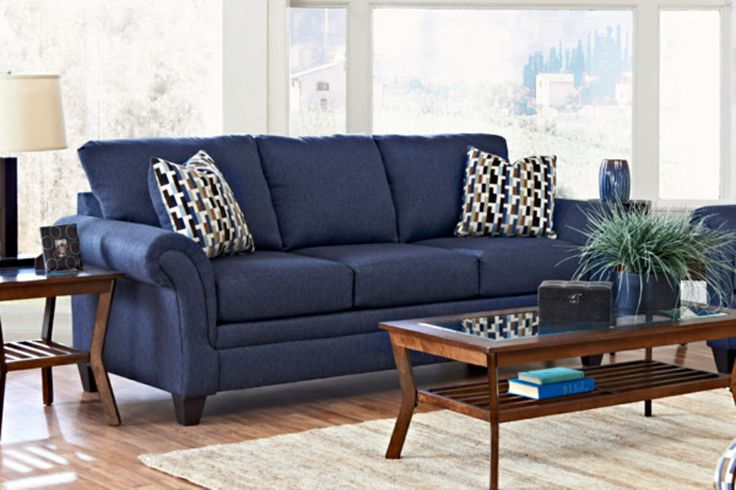Blue Couches Wood Tables Neutral Walls And Flooring