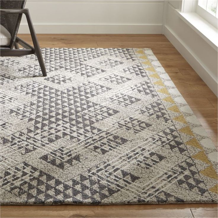 More of a modern girl? This neutral rug with a happy yellow pop is perfect for a cozy living space or a colorful bedroom. Crate & Barrel