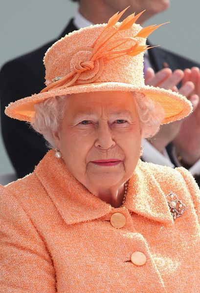 Queen Elizabeth II smile takes part in the naming ceremony for the P&O Cruises vessel at Ocean Cruise Terminal on March 10, 2015