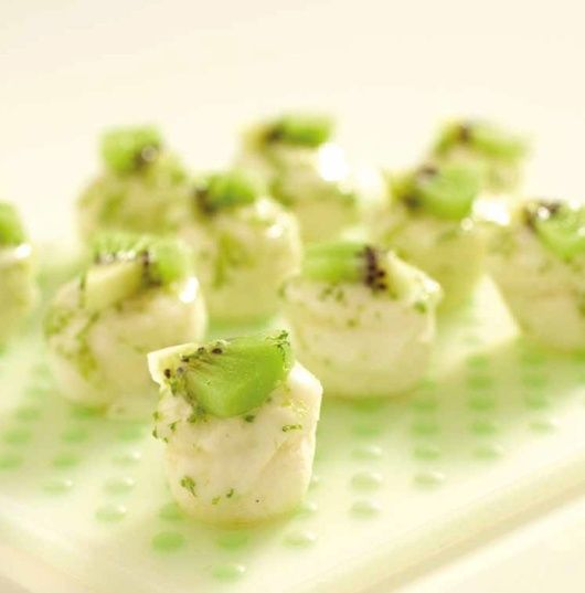 Kiwi Lime Cakes   ¼ c flour 3 tbsp sugar 3 egg whites ¼ tsp vanilla extract Salt ¼ tsp cr. of tartar 2 tsp lime zest 3 tsp lime juice 2 c water 4 tbsp pwd sugar 1 kiwi Mix flour w/ 1 tbsp sugar. Beat egg whites, van. extract, salt & cr. of tartar. Add 1 tsp zest & 1 tsp juice. Add 2 tbsp sugar. Fold in fl. & sug. mix in thirds. Fill mini-muffin tray w/ 1 tbsp batter. Pour water & place roast rack in pot & tray on rack. Cook 325˚F 15 min. Stir zest, 2 tsp juice & pwd. sugar & frost. Top w…