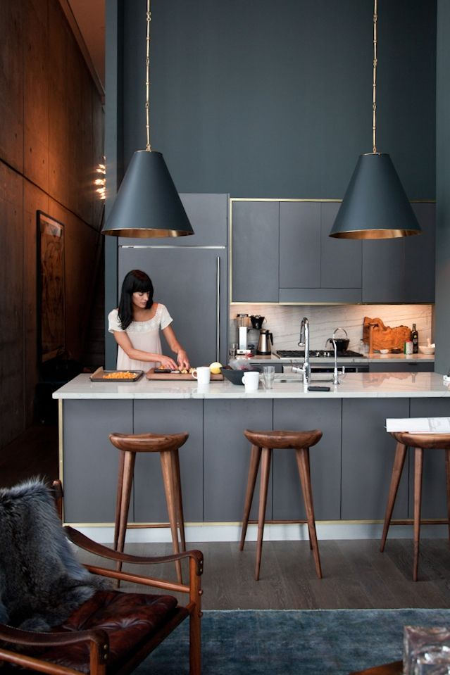 dark inky grey blue kitchen with metallic copper accents
