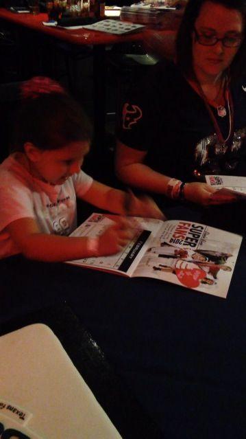Breanna, autographing the calendar for the JJ Watt foundation. She was Little Miss Watt. ❤️