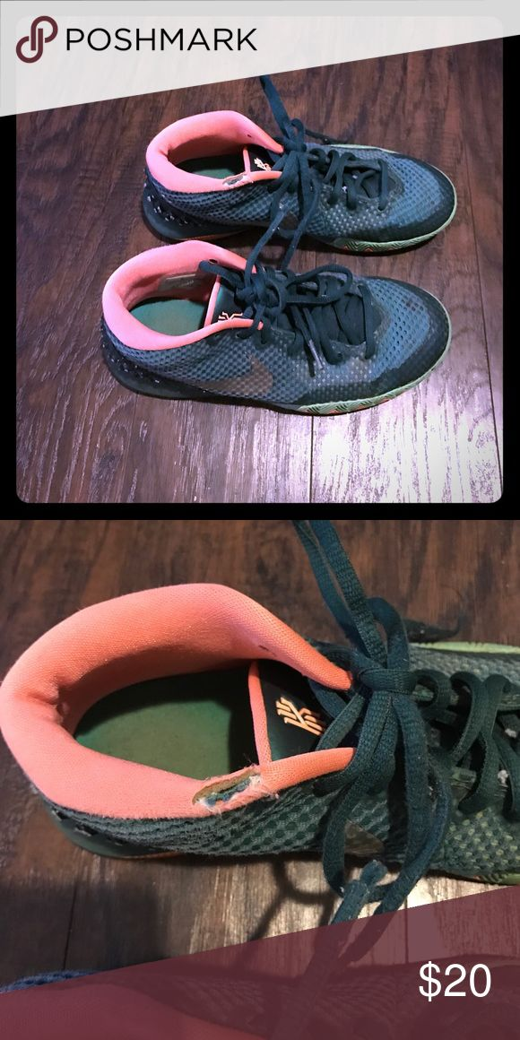 Big Kids Kyrie Irving size 5 Used Big kids Kyrie Irvings. Tear on the top right shoe see 2nd picture Nike Shoes Sneakers