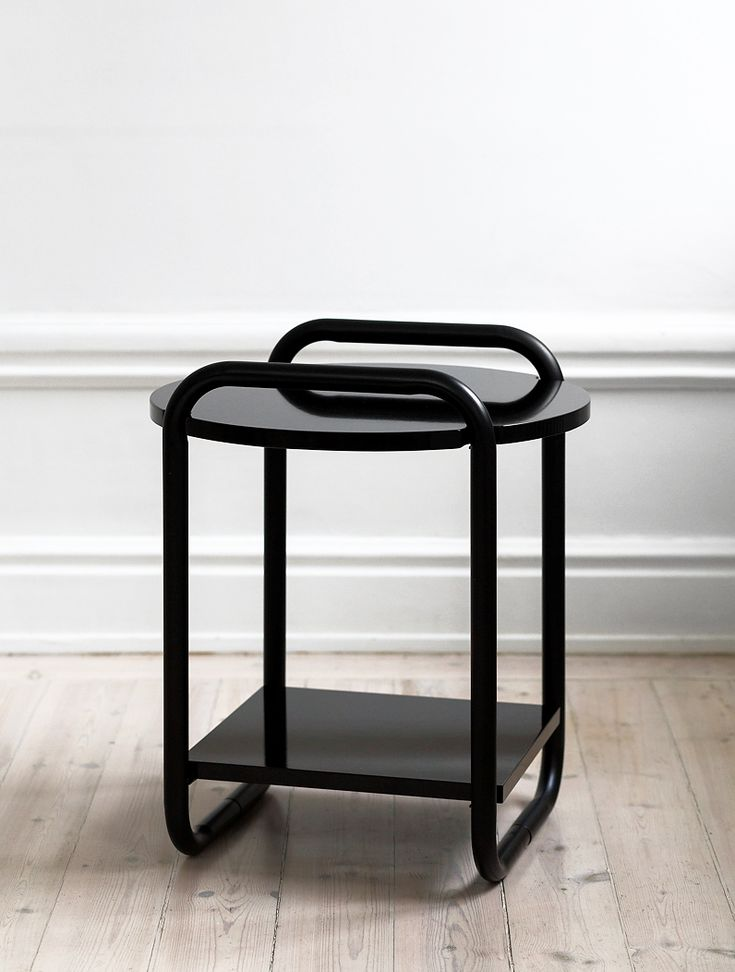 The Vima side table is constructed with a tube frame that continues up to the table's top surface, the frame acting as handles as well. Both of the surfaces are given extra support by the help of magnets bellow.