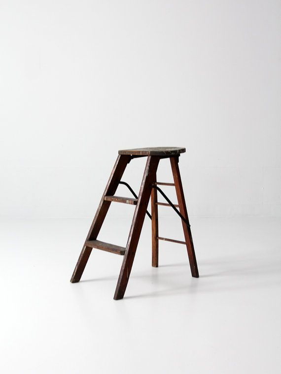 antique step stool  circa 1910s    ○ aged, hard wood step stool  ○ dark brown wood stain tone  ○ half round top seat  ○ old, splattered paint - mainly