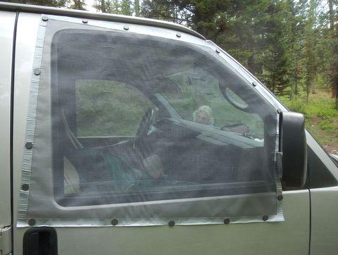 Magnet held window screens