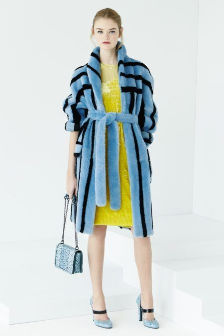Bottega Veneta Resort 2017: blue fur coat over yellow dress with miniature handbag