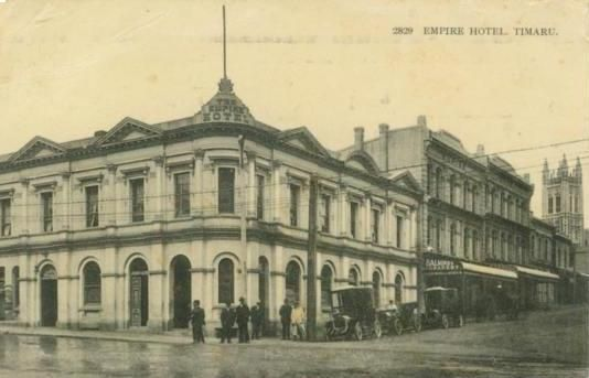 The Empire Hotel, Timaru. Muir & Moodie postcard, 1917. Church St. to the right. St. Mary's Church in the background. Mrs Kenning, proprietress. Alkinds Drapery next door. (cnr Stafford & Church Sts, where Hallensteins is now).