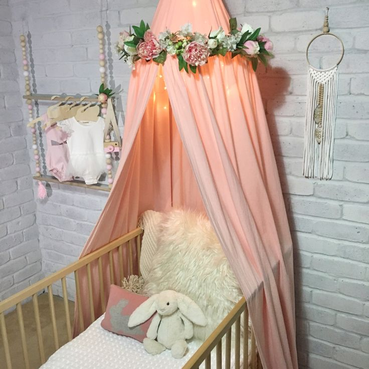 The Avery crib / cot canopy in peach creates the most welcoming, peaceful and serene space in your baby's nursery. A statement piece of nursery decor, enclosing your little baby in their cot, crib or bed away from the busy world for a sweet slumber or decor in an older kids bedroom as a quiet reading nook. I love that the canopy can grow with your child adapting to an array of uses. Pink peony floral wreath available online also.