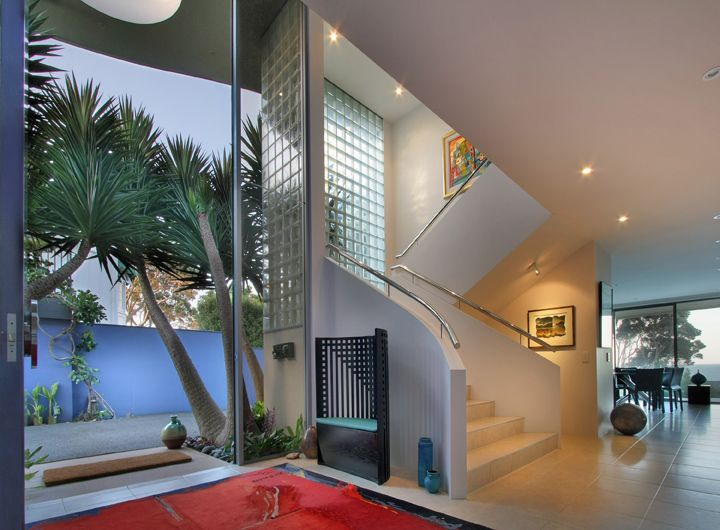 Murrays Bay House foyer with a Sang signature double height door.
