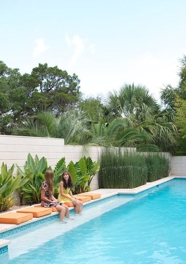 A modern pool/ The seating bench provides a great spot to relax, sip on a glass of wine and catch some rays!