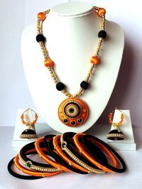 Silk Thread Jewellery Set/ Necklace Set With Bangles & Jhumki Earrings This is a Handmade Silk Thread Jewellery Set For Traditional Wear This is a handcrafted Silk Thread Jewellery Set For Traditional Wear. Colour: Black & Orange Size Of Bangles : 2.4 / 2.6 / 2.8 / 2.10 sizes are
