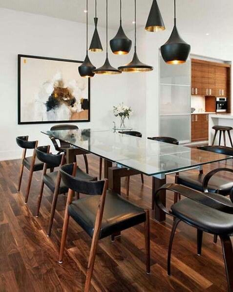 wood floors, glass table, leather chairs, tom dixon lights