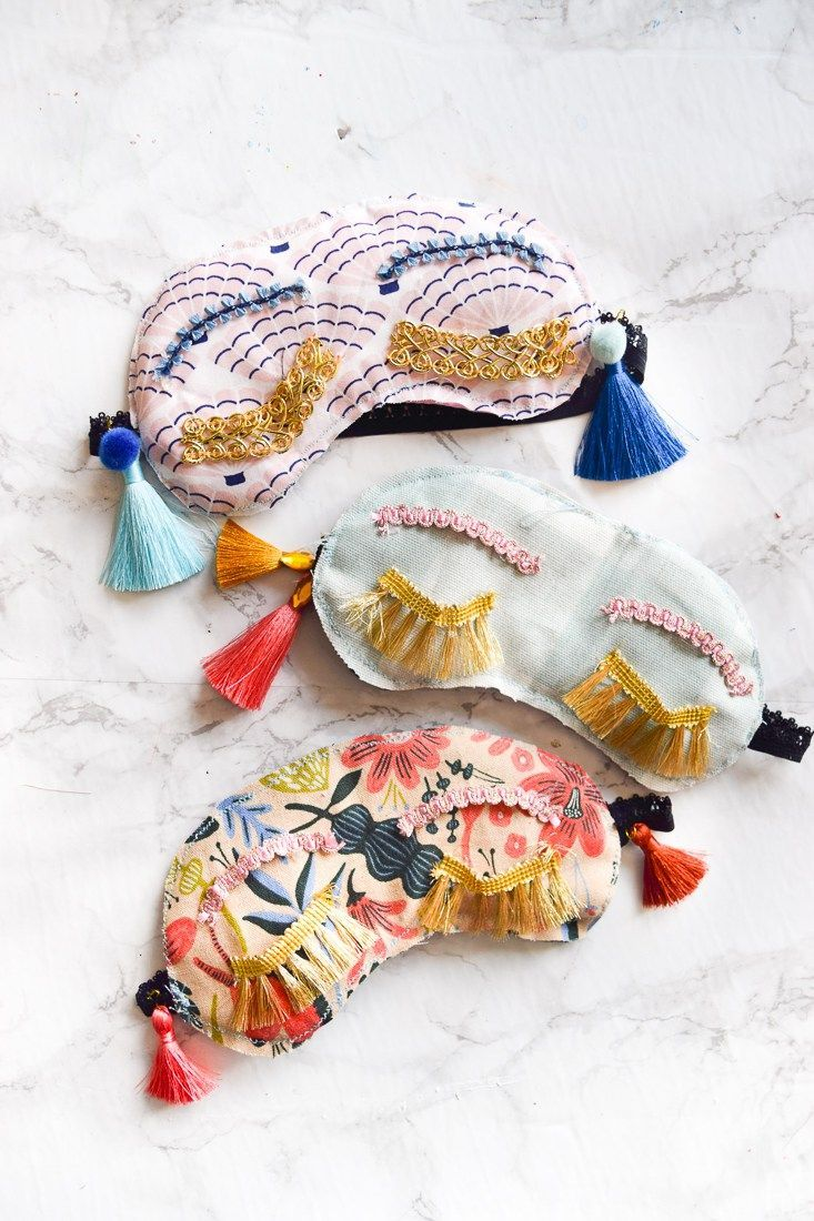 Make your own DIY Holly Golightly Sleep Masks with the supplies you may already own. Colourful tassels and pom poms, fringe, and fabric scraps are all you need!