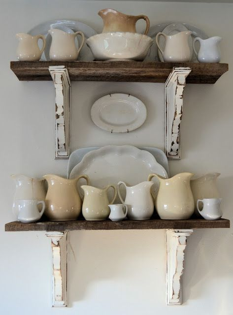 braces/ corbels painted ironstone white, natural wood shelves, multi-white ironstone pitchers and platters