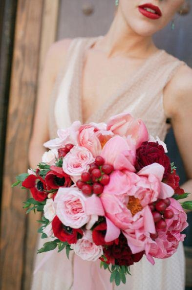 lush pink peonies, roses with bright red anemone and berries