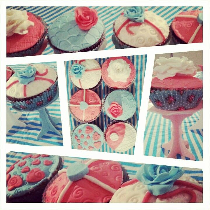 Red velvet cupcakes with red blue and white fondant designs of roses flowers hearts stamped fondant