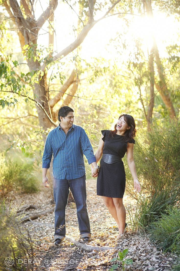 Classic blue and black combine for a gorgeous engagement photo. Don't be afraid to show off your figure with a body hugging dress but not too short on the hemline! Photography by DeRay & Simcoe