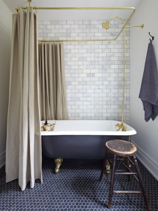 Black tub with Brass Shower Curtain Rails + Brass Fixtures | How to Get the Vintage Look in Your New Bathroom | Apartment Therapy