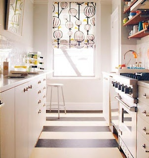 I love this black and white striped linoleum floor with the black and white fabric over the window. It grounds the space and it also feels so much more FUN and less SERIOUS. Almost all kitchens scream serious money, and not to our benefit. It's stressful to the DIYer.