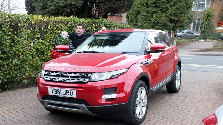 Land Rover Evoque sports model in red.