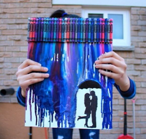 Use crayons of your choice and a blow dryer and something round (for the umbrella) to create a cute bf and gf art DIY.