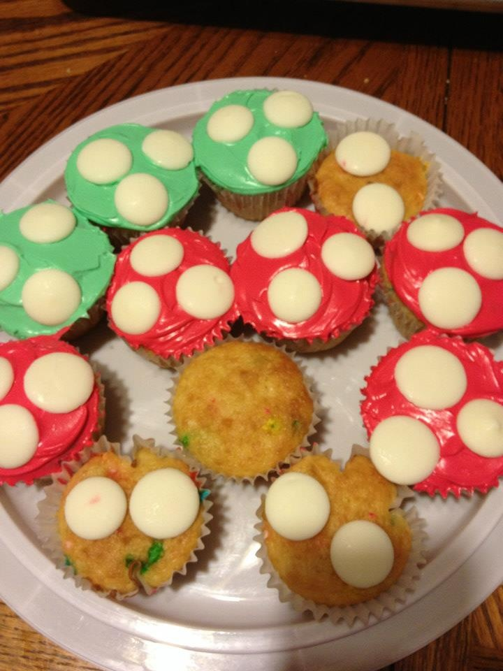 """Also for my boys 6th birthday Mario style, they wanted cupcakes so they could have """"big man"""" mushrooms too. I do have one birthday boy though that has decided he no longer likes/wants icing so we had to have some naked but I still put the dots on a few."""