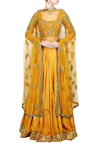 Featuring a raw silk mustard yellow lehenga with embroidery on the hemline , it comes with a scoop neck blouse with silver thread embroidery and net sleeves , paired with a matching net dupatta with silver border and embroidery #Beige #floral #embroidered #anarkali #NewIn #Carma #Online #Shop #CarmaOnlineShop #WorldWIdeShipping #COD #ShopNow #FreeShipping