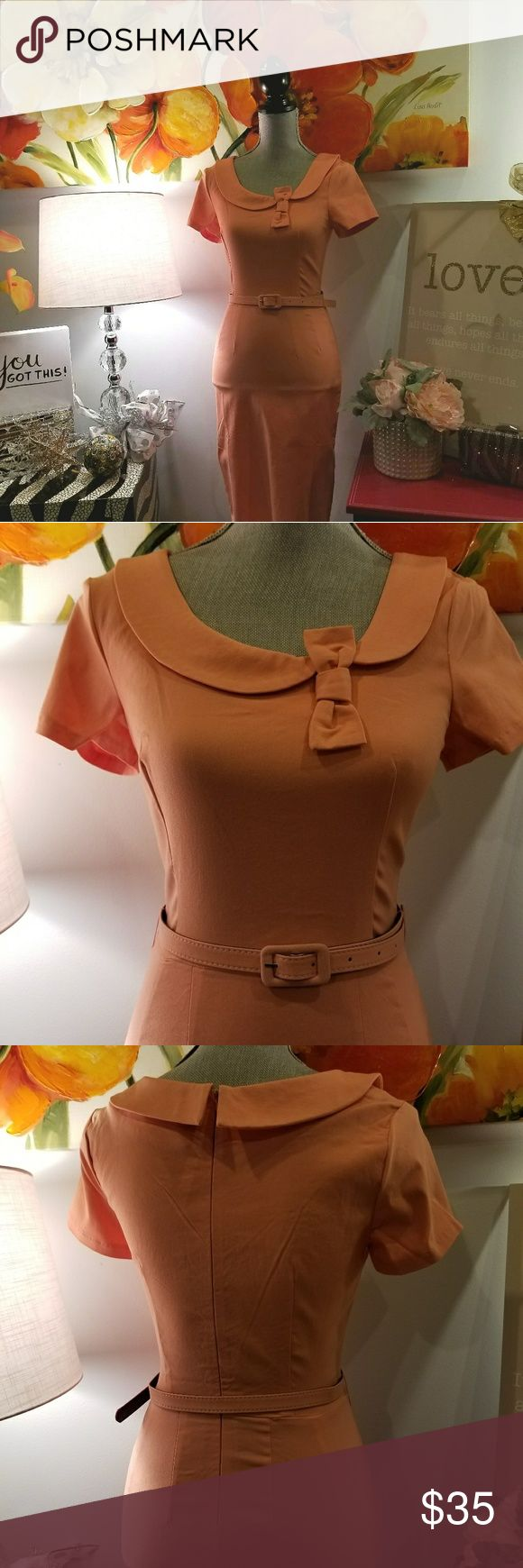 """NWT Vintage Pinup Dress Short sleeved, collared, belted dress. Little bow accent. Split up the back of skirt. This form fitting dress flatters the figure. The fabric blend is rayon, cotton and spandex. Color appears orange in the pictures but it is actually a salmon pink. Measurements: waist-14, bust-17; hips-18; length-42"""". Very pretty dress. Dresses Midi"""