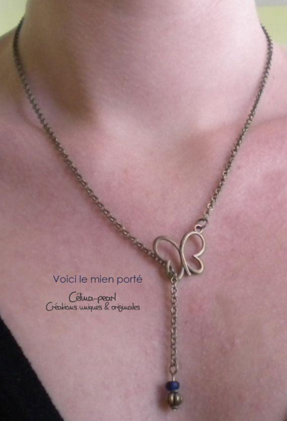 Collier bronze papillon son bijoux de dos rouge