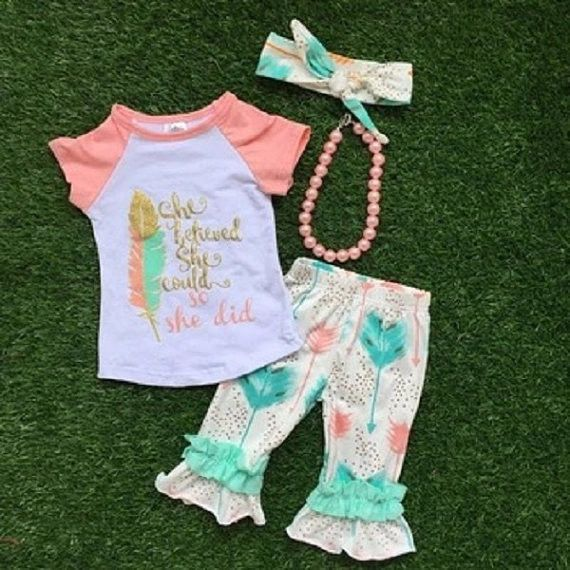 """Our little girl outfit with arrow print ruffled capri pants with """"She Believed She Could So She Did"""" written on the top is an adorable top quality baby girl's boutique outfit. Trendy, popular, and com"""
