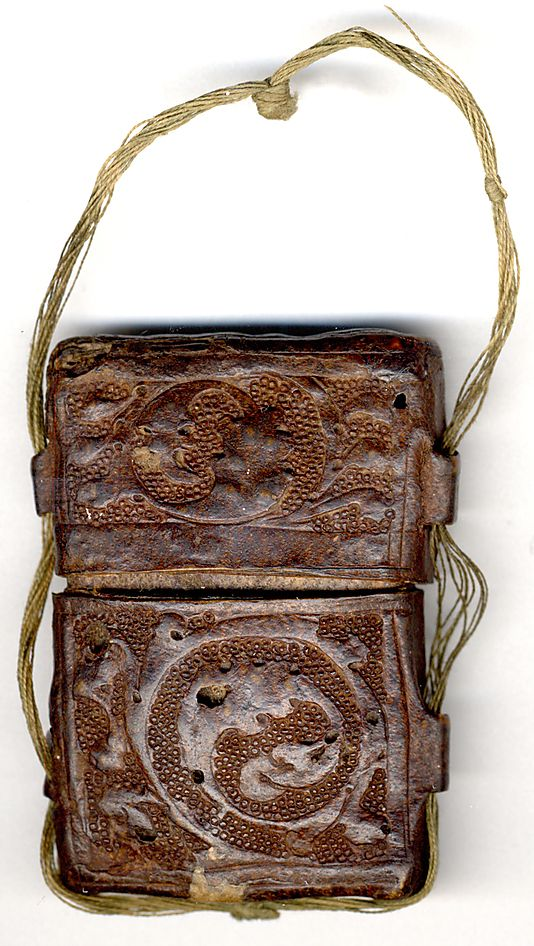Case for Enamel Diptych Date:     14th century Culture:     British Medium:     Cuir bouilli (tooled leather) Dimensions:     Overall: 2 3/16 x 1 5/8 x 11/16in. (5.5 x 4.2 x 1.7cm) Classification:     Leatherwork Credit Line:     Gift of J. Pierpont Morgan, 1917 Accession Number:     17.190.2097b