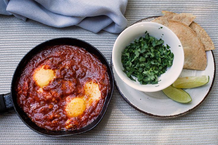 "Huevos ahogados en salsa guajillo.  Huevos ahogados means ""drowned eggs"" in Spanish. Try this easy brunch recipe!"