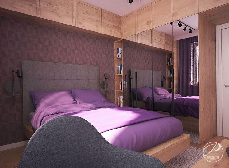 Kolor w mieszkaniu. Projektowanie mieszkań Warszawa Sypialnia, której nowoczesność przełamuje wposażenie wykonane z drewna oraz dodatki dekoracyjne w kolorze fioletu i szarości.  | Progetti Architektura