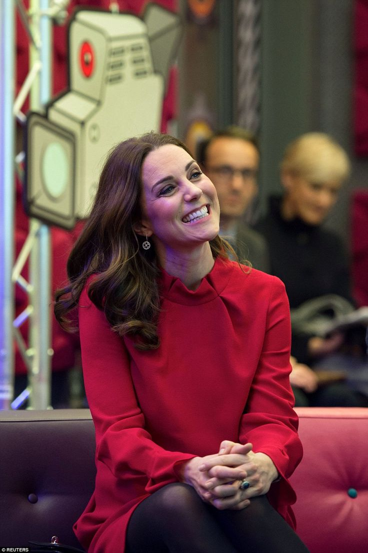 Kate looked animated as she smiled while listening to a question and answer session with y...