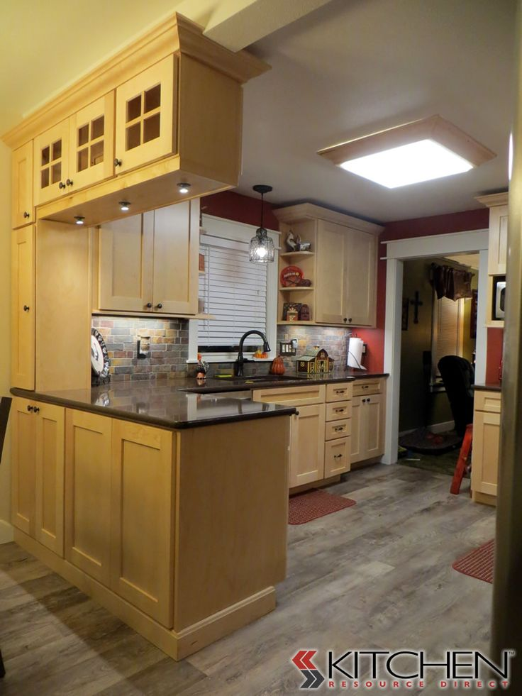 A Craftsman Style Kitchen With Natural Maple Stained Shaker Cabinets. Dual  Sided Storage At Island