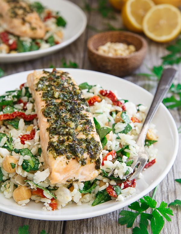 This quick and easy garden pesto salmon is served on top of a Mediterranean rice for a healthy meal that can be on the table in less than 30 minutes.