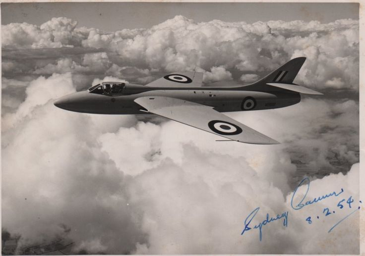 CAMM SYDNEY: (1893-1966) English Aeronautical Engineer and Aircraft Designer, famous for the Hawker Hurricane fighter plane. A good vintage signed 6.5 x 5 photograph depicting the Hawker Hunter Prototype WB188 designed by Camm in flight over some clouds. Signed by Camm in blue fountain pen ink to a clear area of the image and dated 8th February 1954 in his hand. Rare.