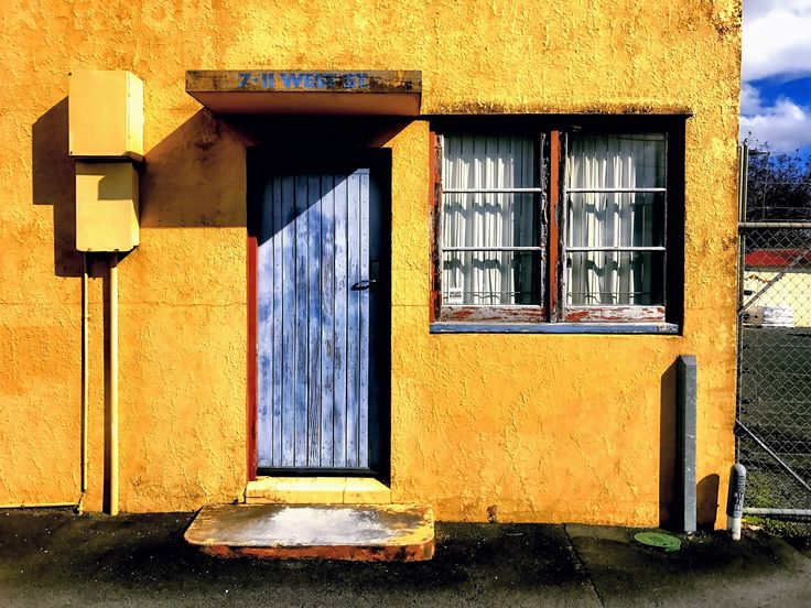 Old building. This is an old building in my town. I had to visit this place twice to get the lighting right. Worth the effortI thought.  #stusroadtrips #oldbuilding #newzealand #photo #photograph #street #streetphotography #streetview #windows #door #woodendoor #doorsandwindows #old#wooden #bluecollar #nz #lightanddark #fence