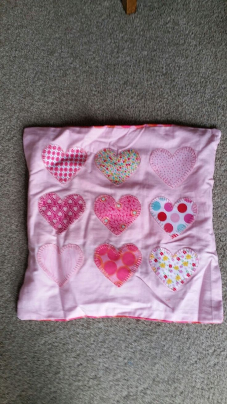 Pink heart blanket stitched cushion