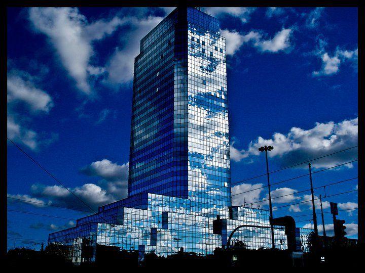 Cloudy skyscraper in Warsaw, Poland  http://studyfun.pl http://blog.studyfun.pl