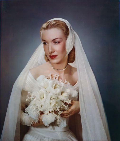 white feather covered headpiece and flowing veil. #vintage #bride #wedding #dress #bouquet #1940s #hair