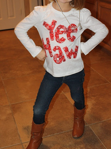 """Fun way to make an outfit for """"western day"""" at school: bandana fabric, cut letters, sew on blank t-shirt."""