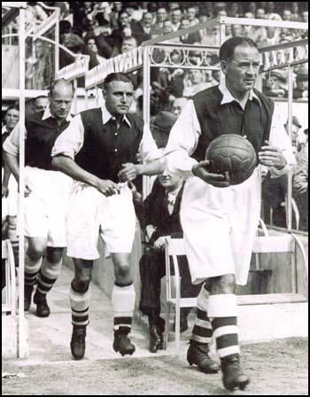 Alex James leading the Arsenal team out at a game at Highbury.