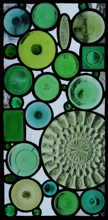 Green Bottom 7 is the latest in the Green Bottoms series. It features a collection of objects around a large plate. The glass between the green objects is a variety of handblown glasses.