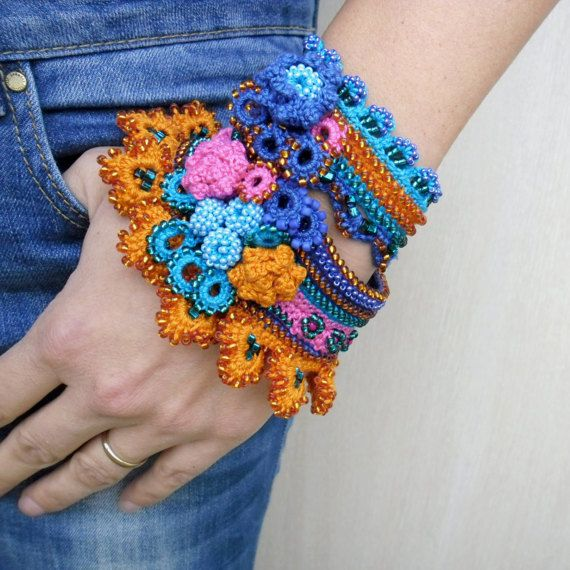 Unique beaded crochet bracelet cuff in orange, deep blue, cerulean blue and pink colors. This bracelet crochet from 100% cotton thread, is