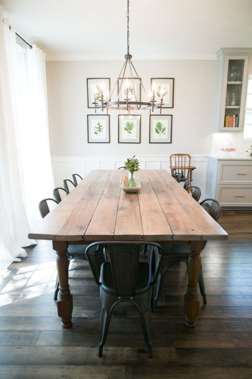 farmhouse dining room with wood table and metal chairs slightly different colors on walls in kitchen cabinets