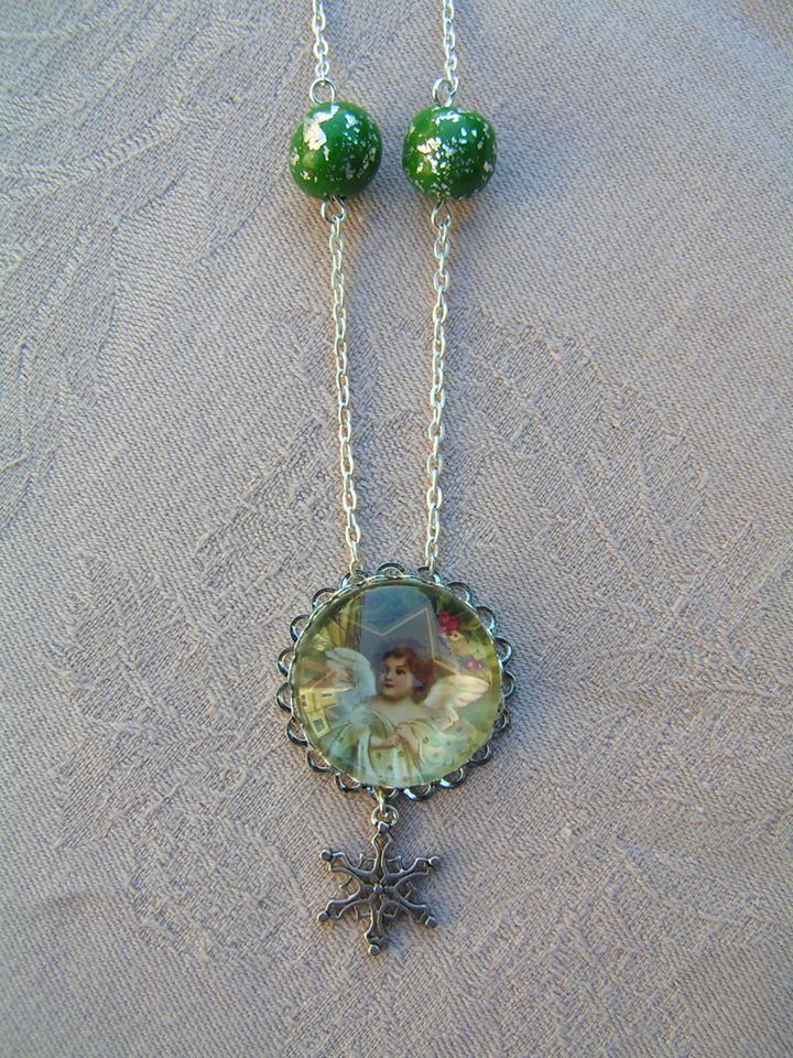 Angelic Salutation  --    Lovely silver plated glass cabochon picture necklace with (silver) metal leaves decorated polymer clay beads and a small snowflake charm.